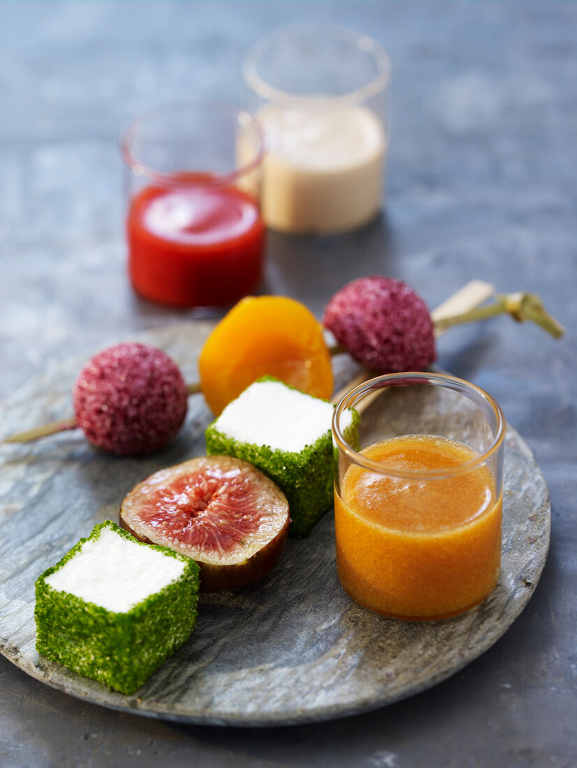 Disguised marshmallow and fruit brochettes ,smoothies