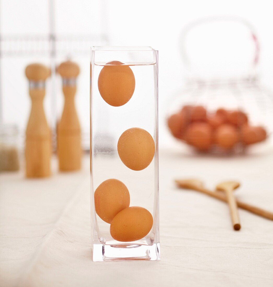 Eggs floating in a container of water