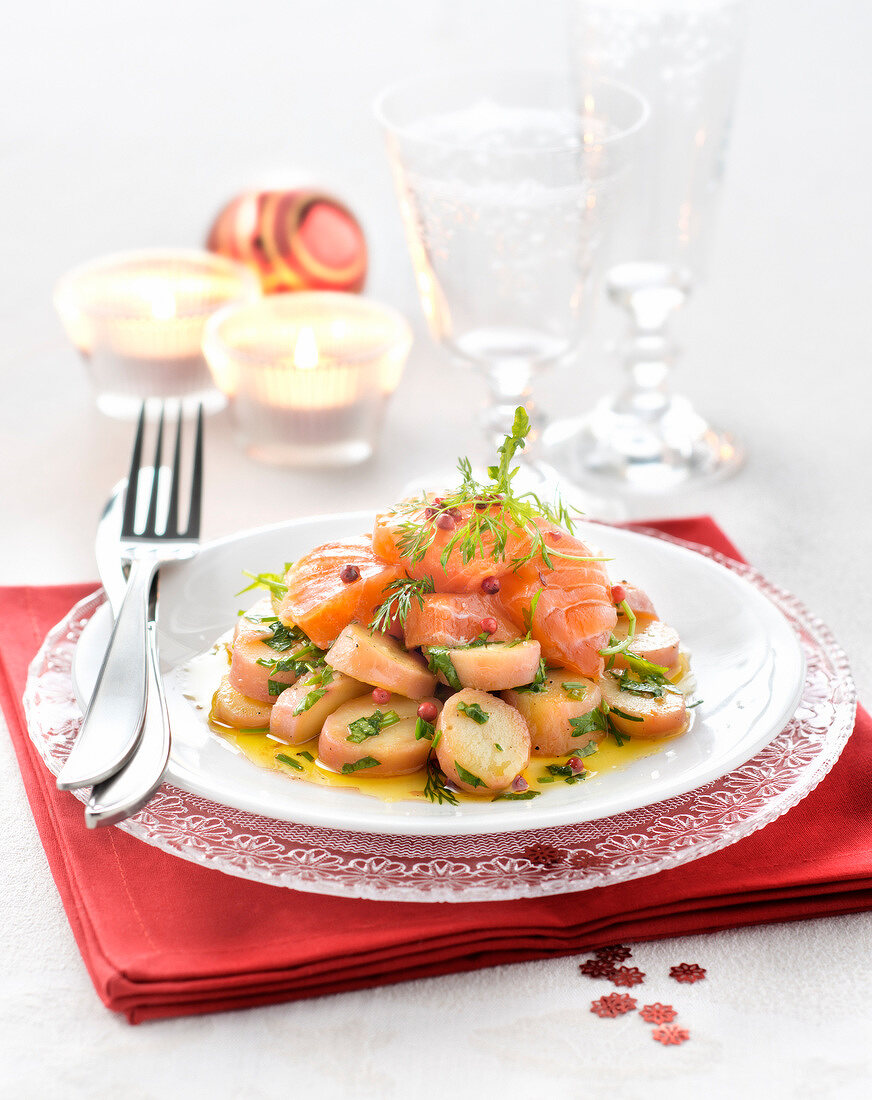 Potato salad with salmon marinated in oil,dill and pink peppercorns