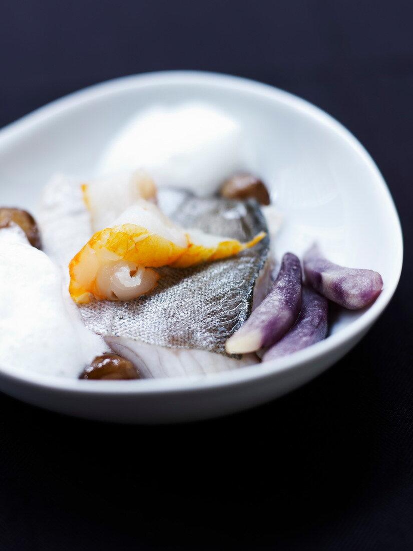Fresh and smoked haddock with babana purple potatoes