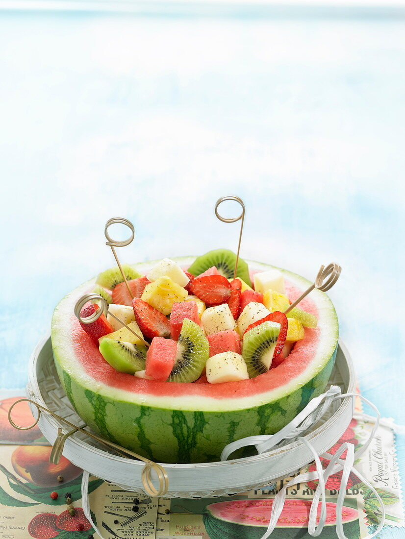 Fruit salad served in half a watermelon