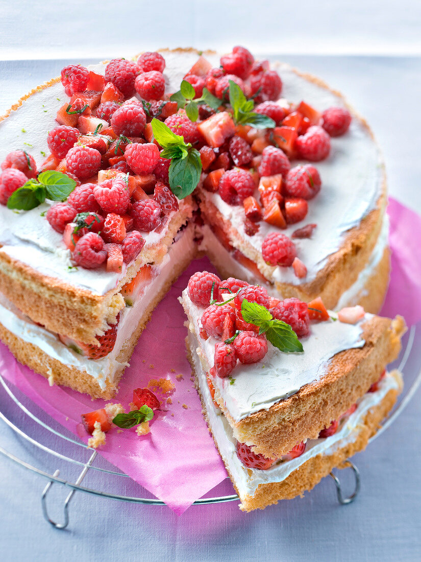 Lyered sponge cake with lime cream filling with fresh strawberries and raspberries