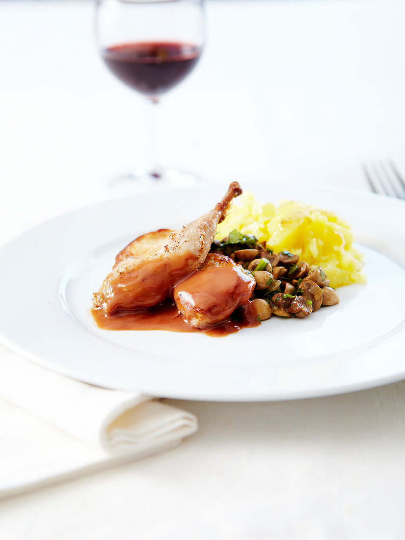 Quail in whisky sauce,pan-fried mushrooms and mashed potatoes