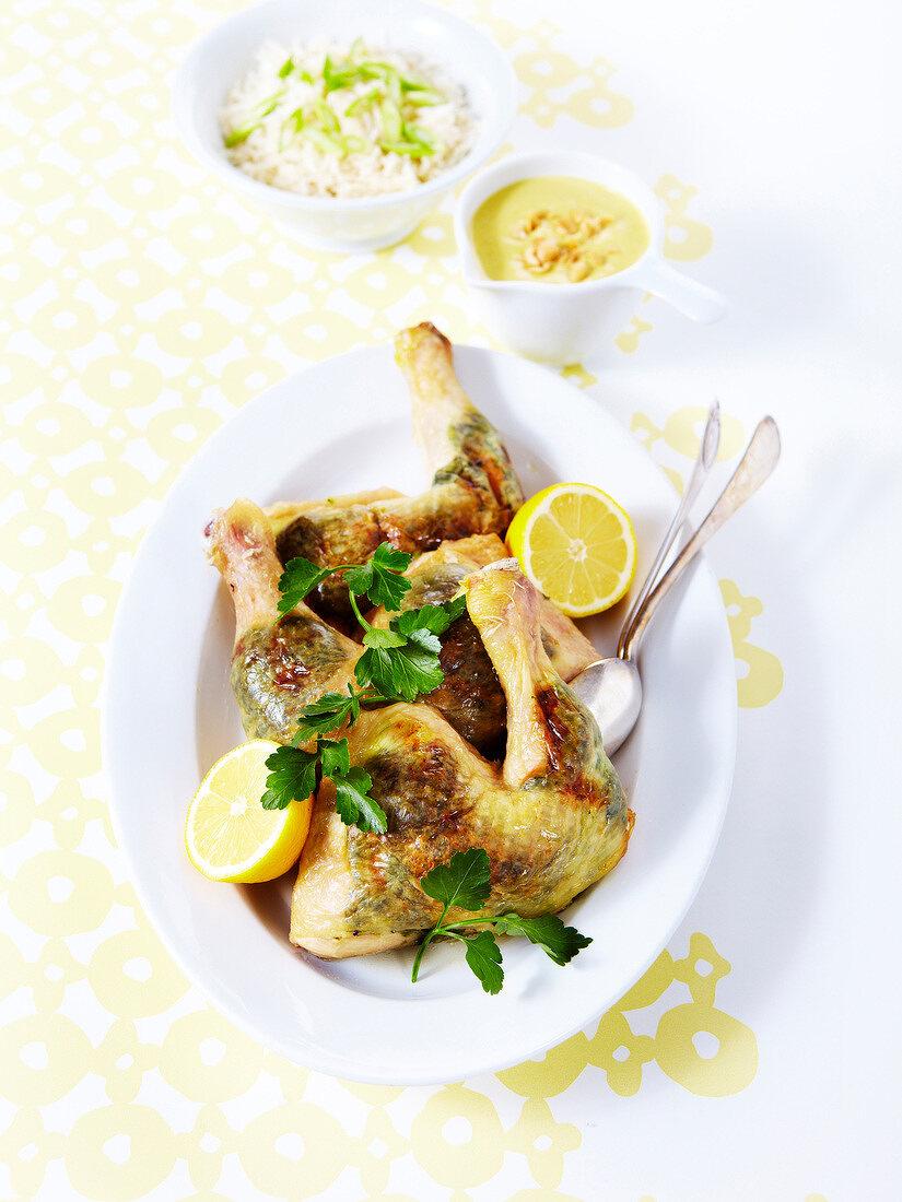 Roast chicken with herbs under it's skin, lemon