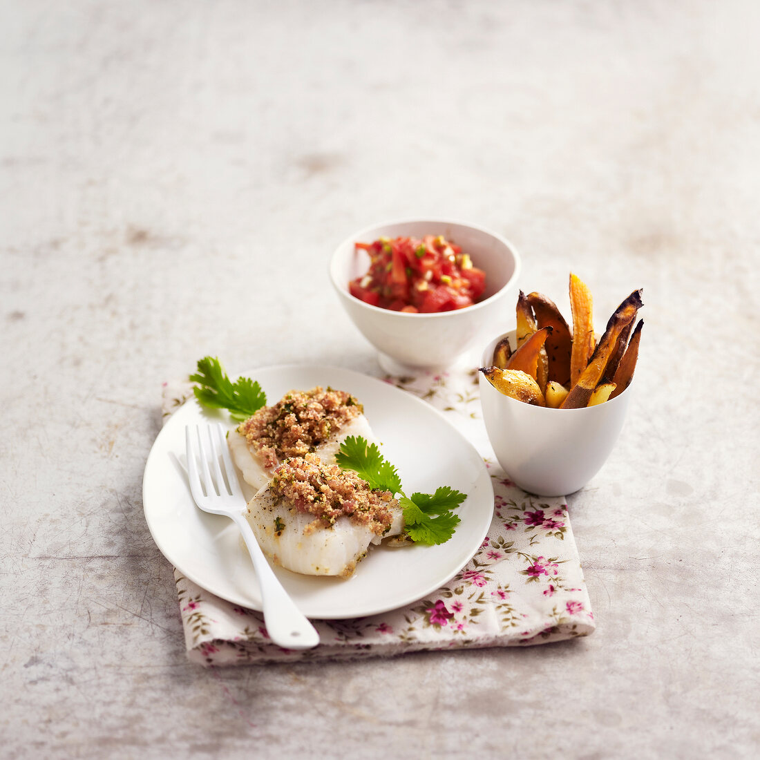 Cod topped with raw ham crumble, sweet potato fries,tomato salad