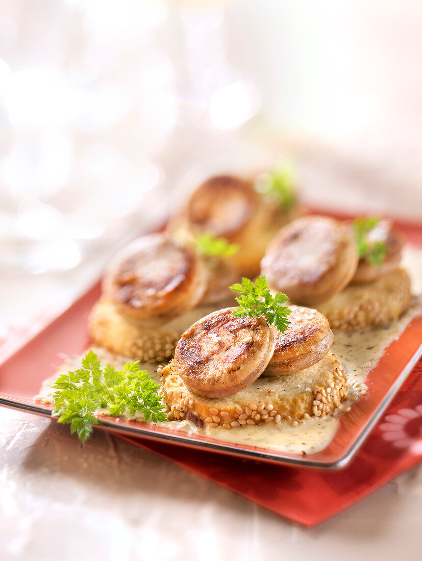 White sausage and on shortbreads and mustard cream
