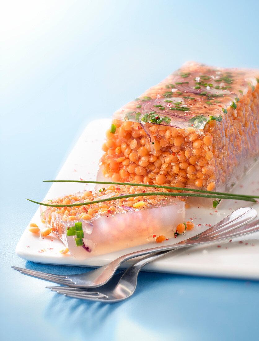 Orange lentil aspic terrine