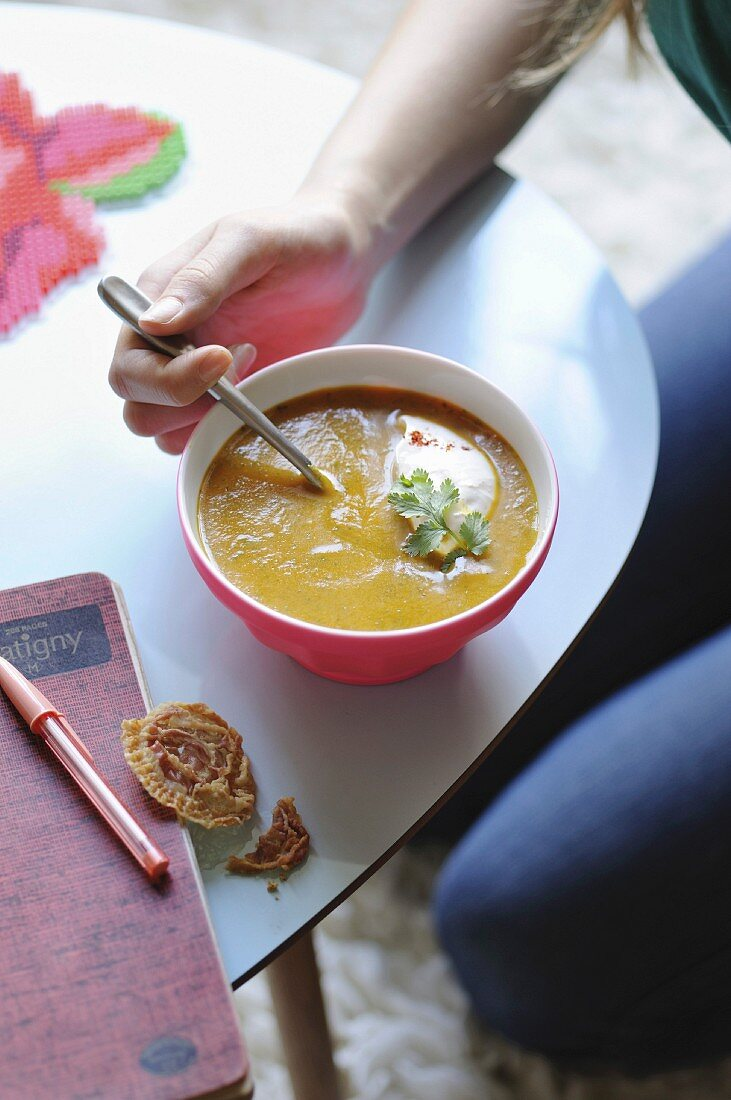 Sudent eating an Oriental-style carrot soup