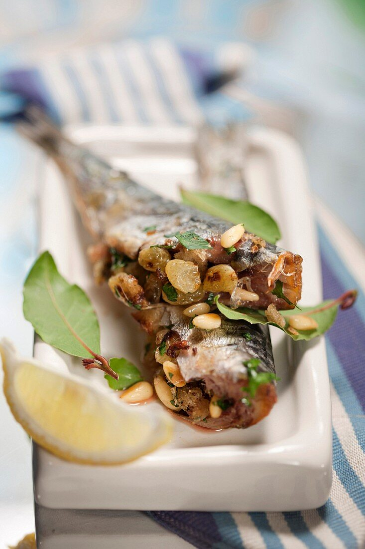 Sardines stuffed with onions, raisins and pine nuts