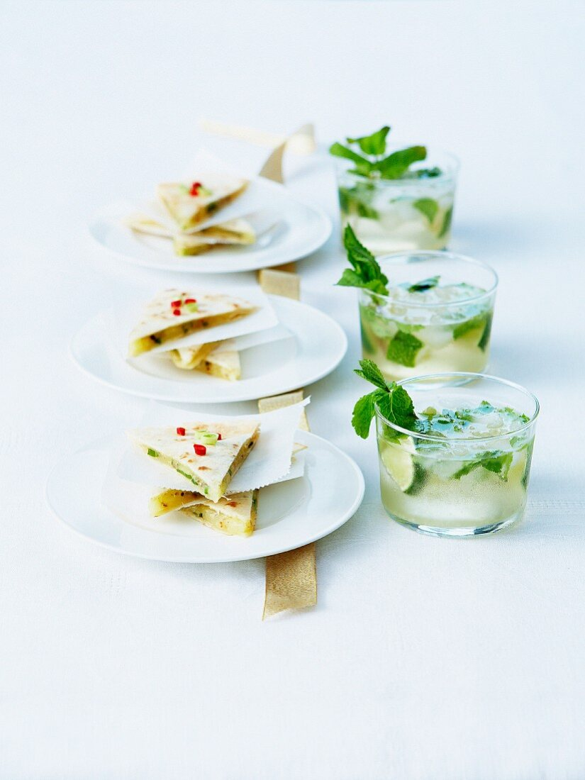 Cucumber jelly and hot pepper quesadillas appetizers and mojitos