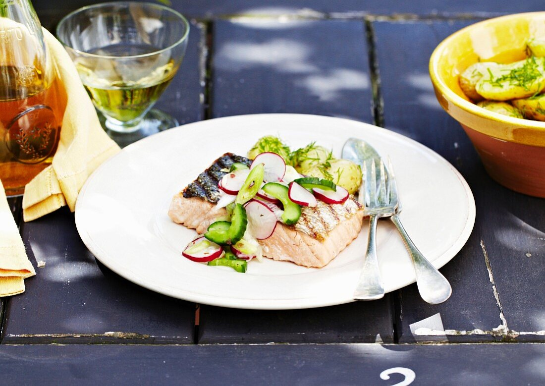 Grilled salmon with dill,radish and cucumber salad