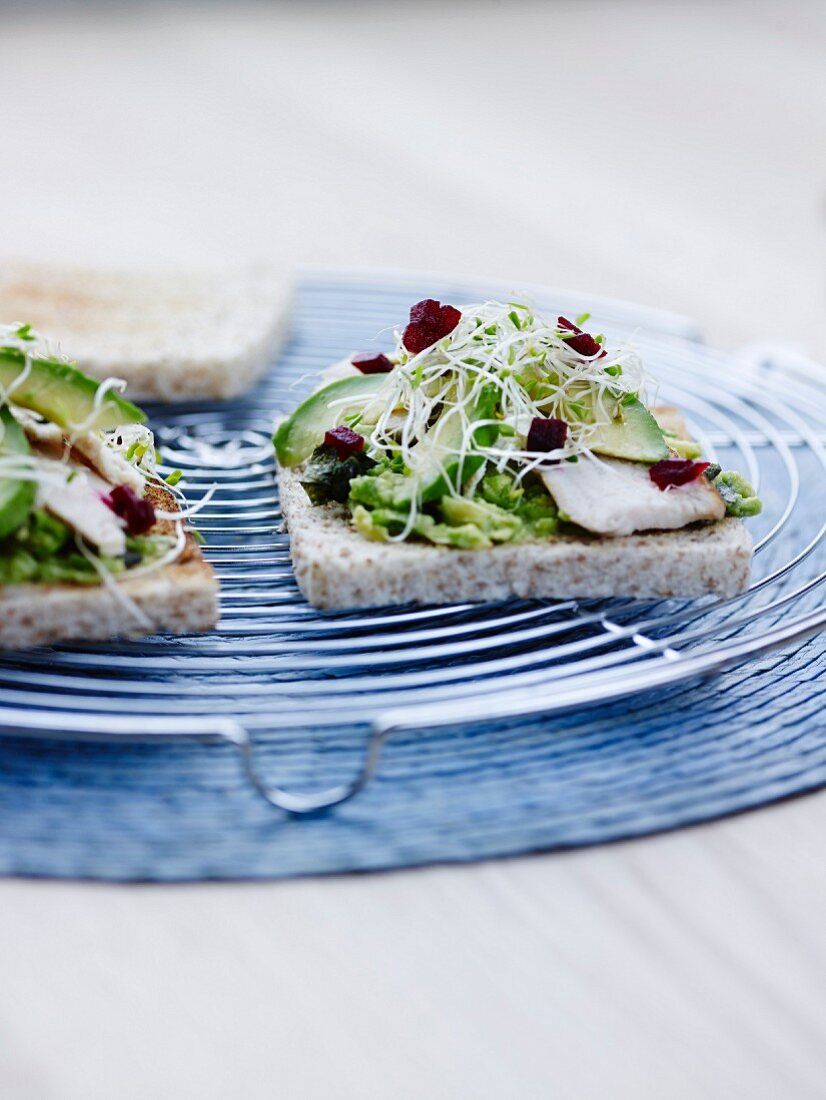 Avocado,sprout,wasabi and beetroot cereal bread sandwich