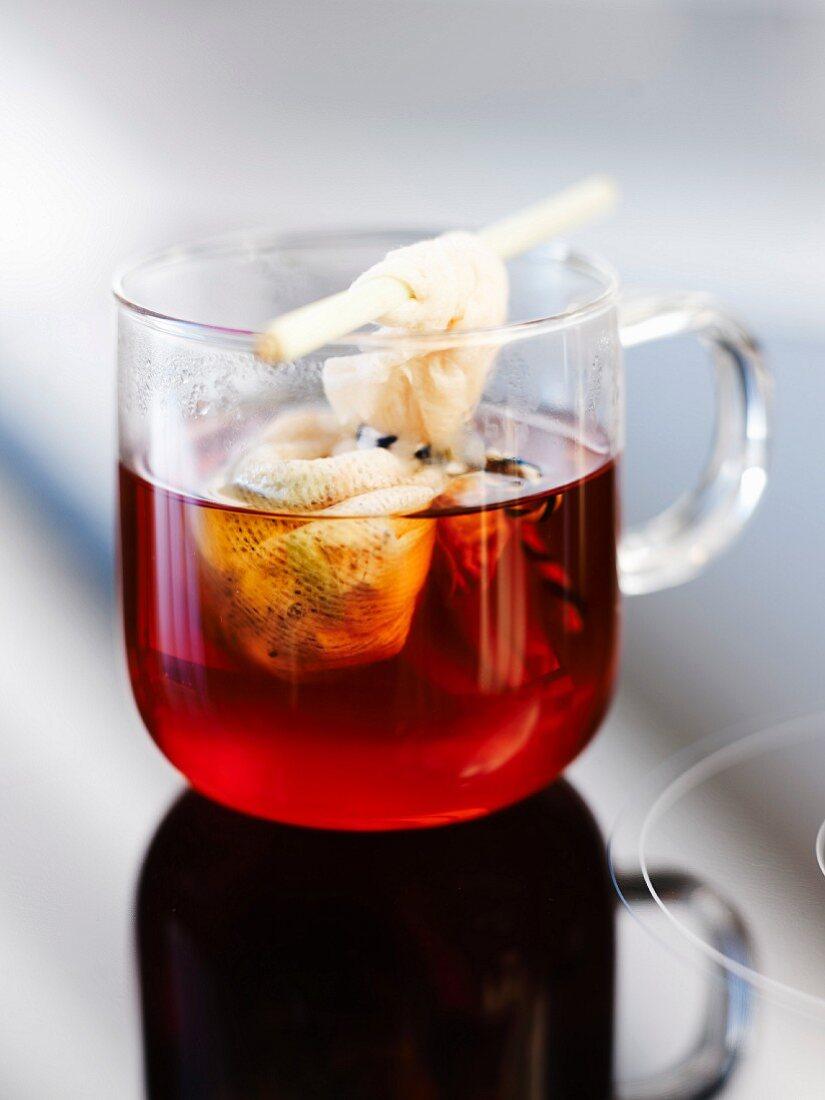 Jasmin tea with hibiscus flower, cardamom and lemon tree honey
