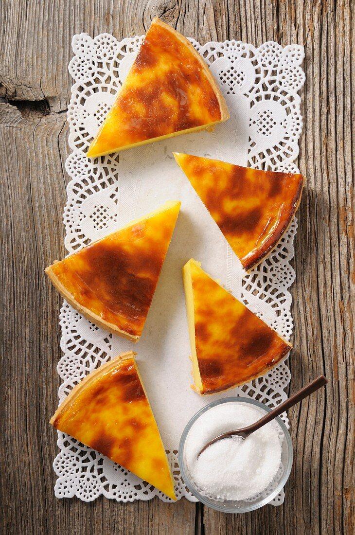 Slices of baked egg custard pie