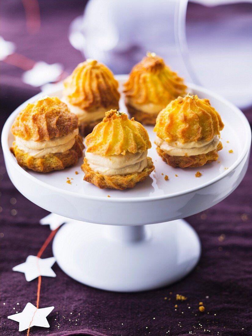 Small macaroon-style cream puffs