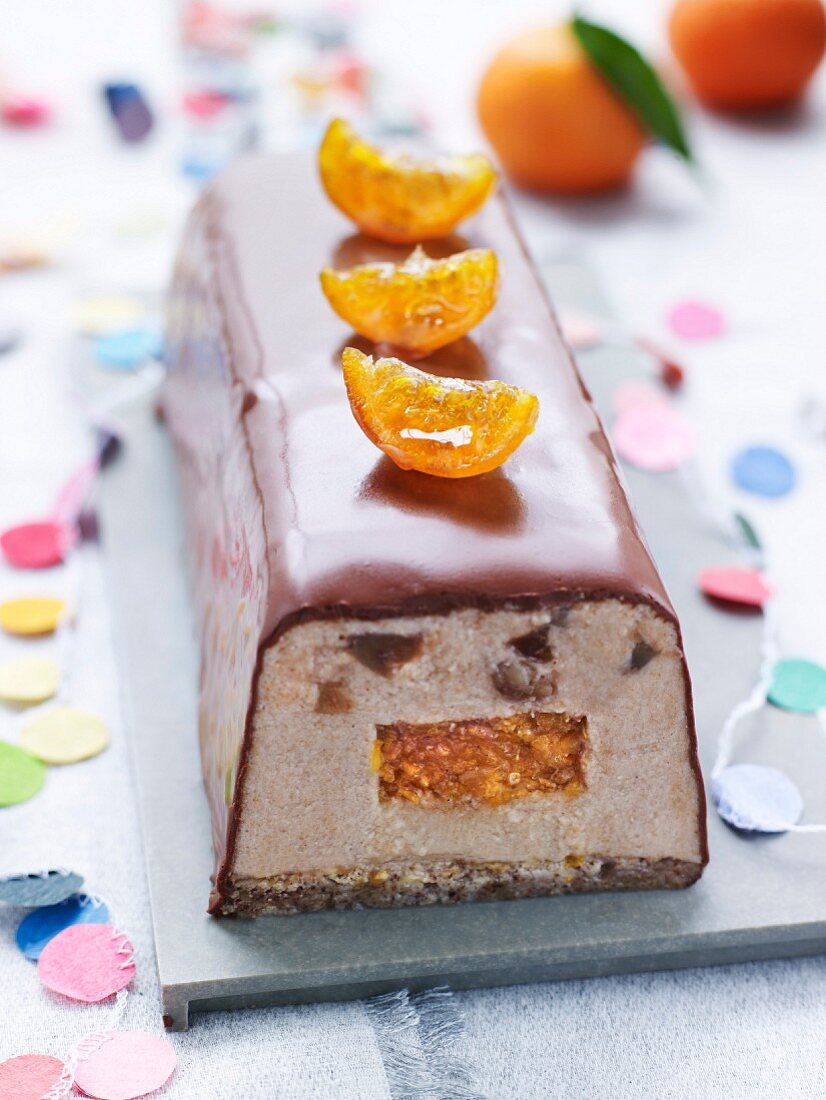 Chestnut and date ice cream log cake with confit clementine
