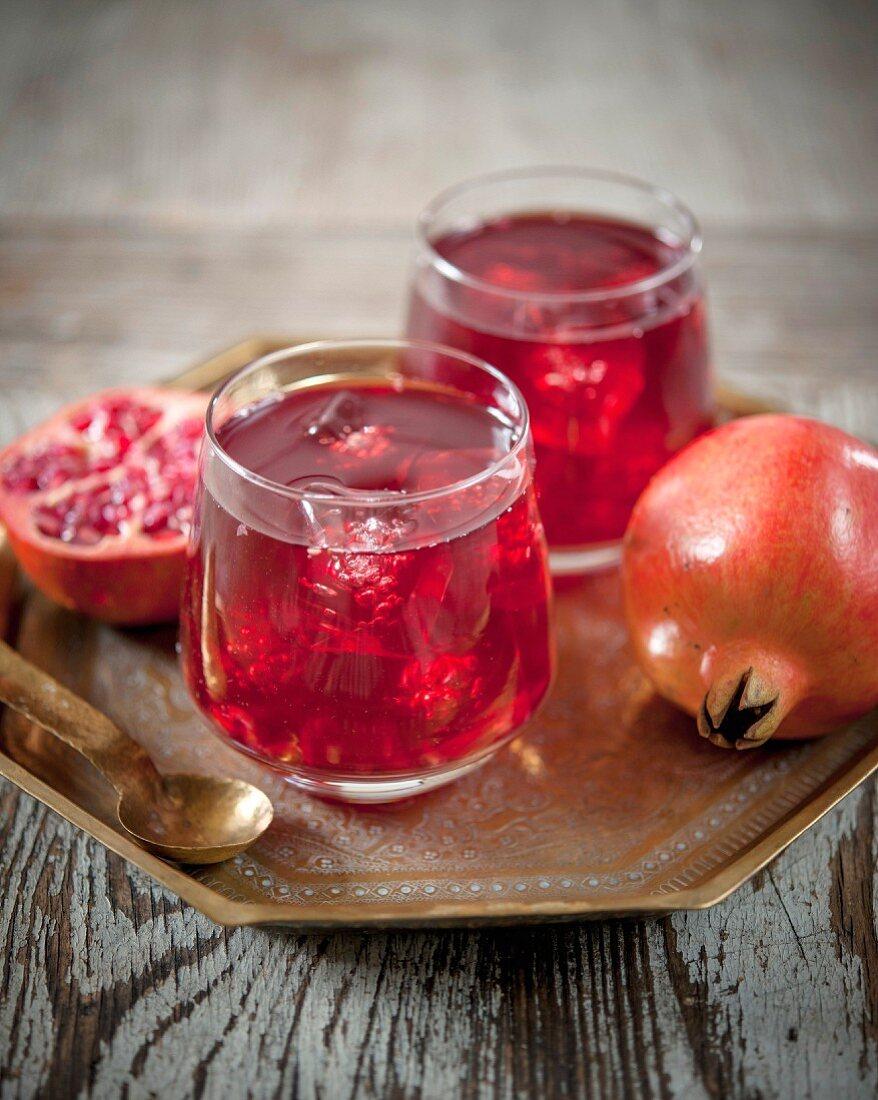 Glasses of pomegranate cordial