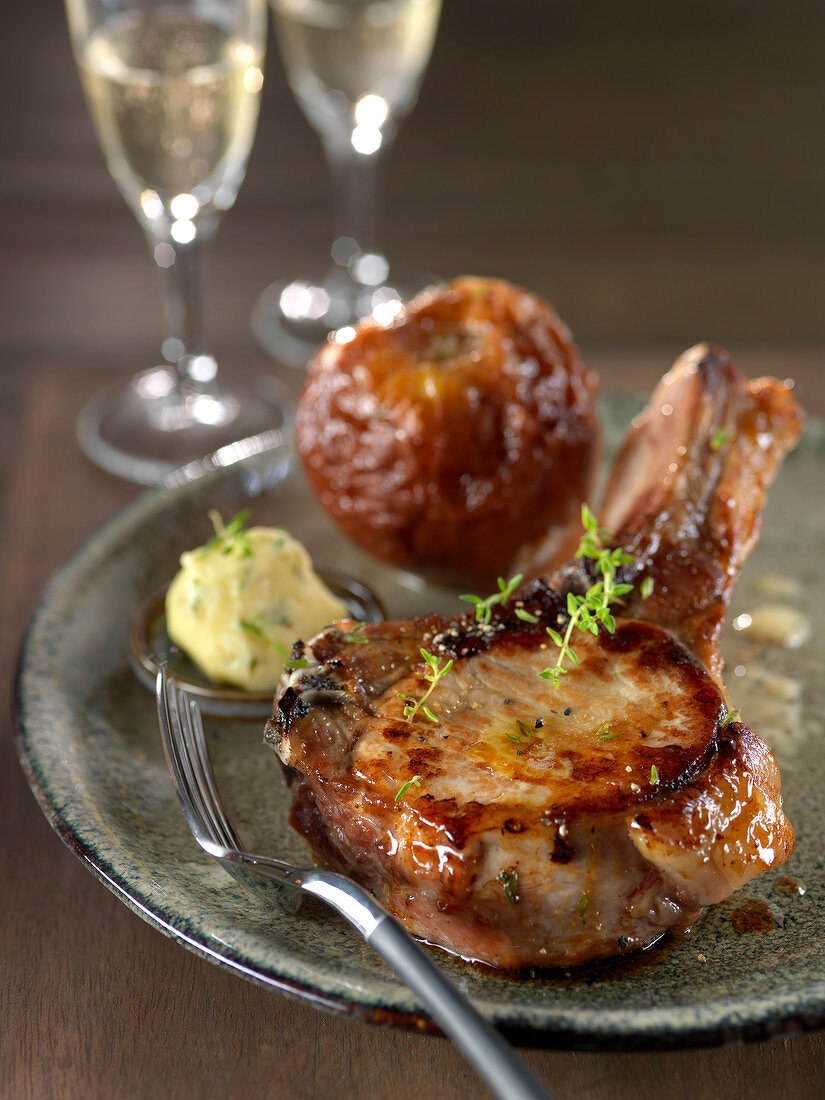 Grilled veal chop, parsley butter and caramelized baked apple