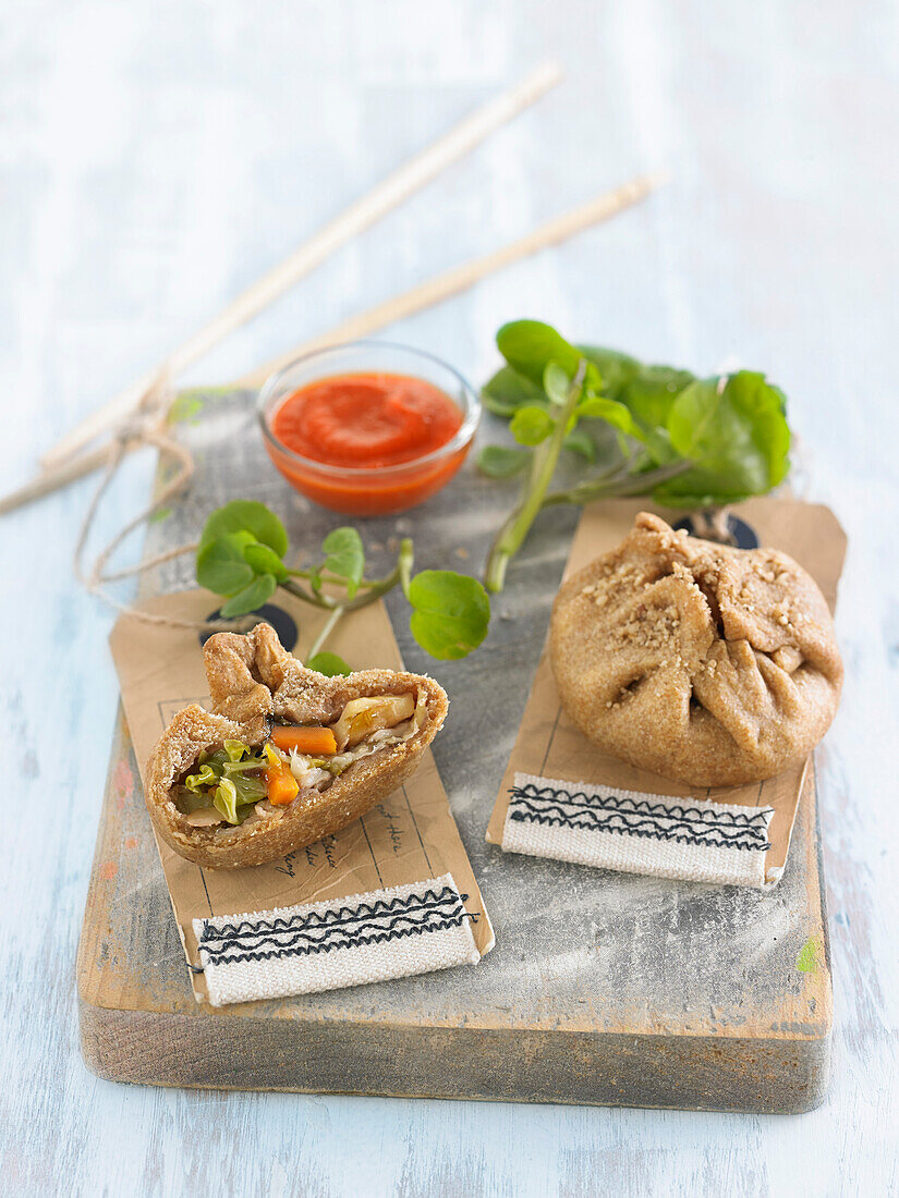 Small pancakes stuffed with shiitake and cabbage, bell pepper sauce