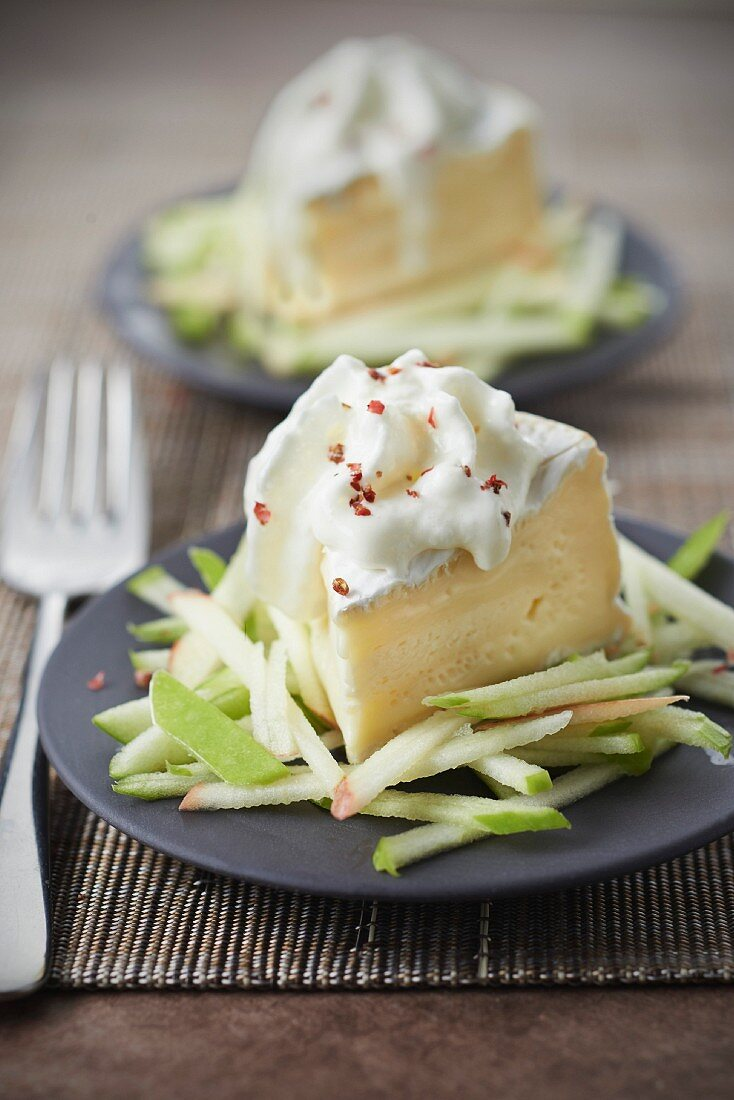 Camembert with thinly chopped apple and camembert whipped cream with pink peppercorns