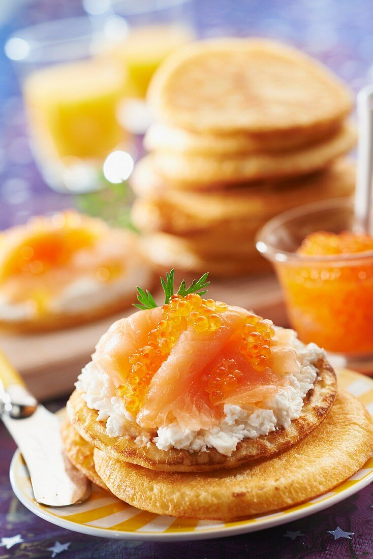Mini pancakes topped with crumbled Petit Billy,smoked salmon and cod roe