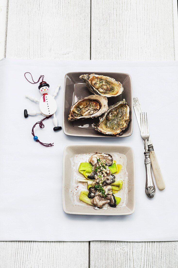 Oysters grilled with hazelnuts,raw oysters on a bed of leeks,nutmeg vinaigrette