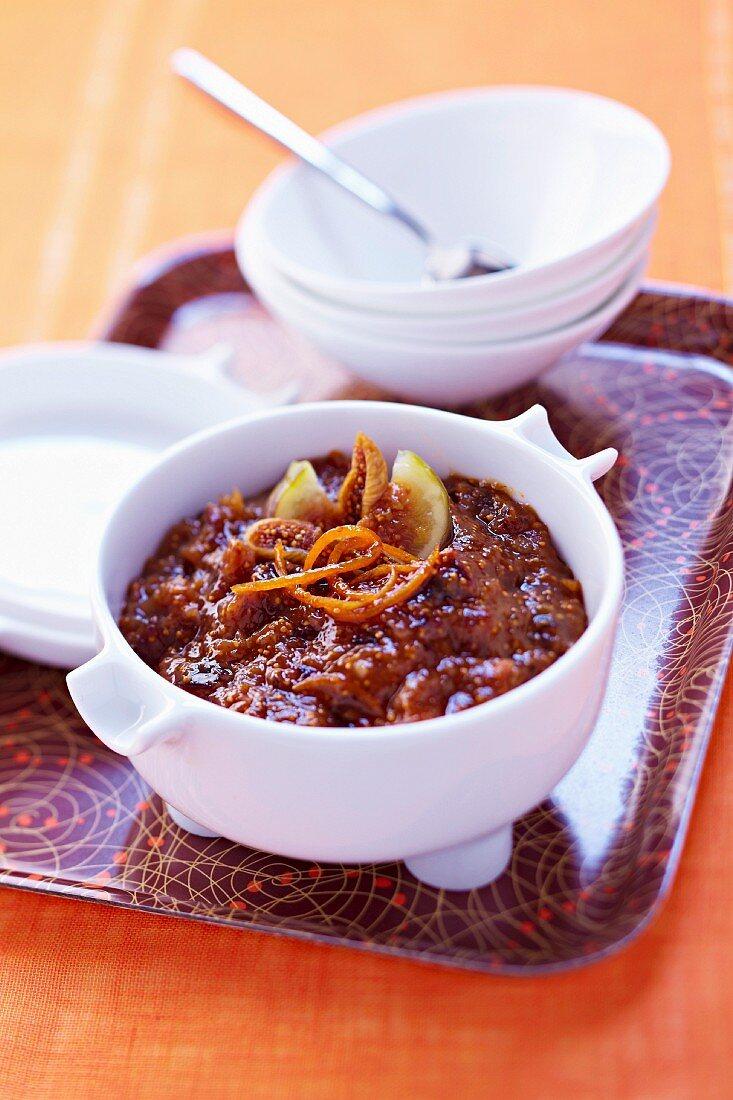 Two varieties of stewed figs with orange zests