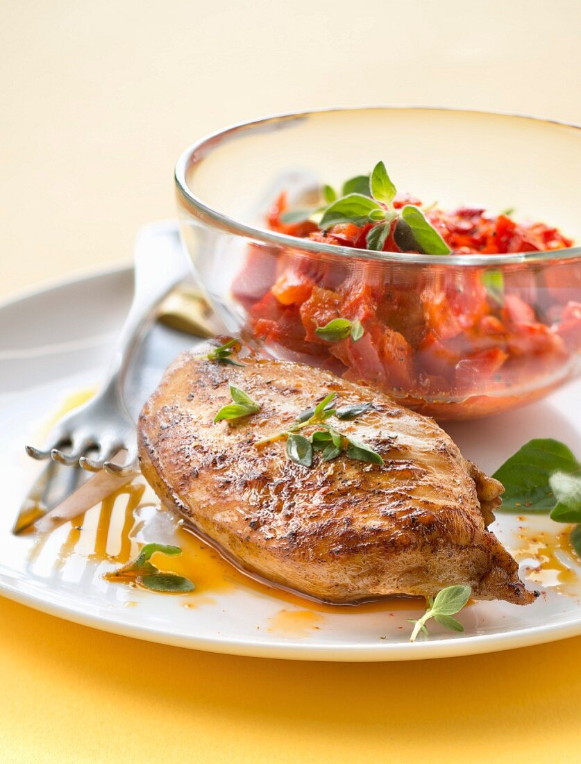 Grilled chicken breast with stewed red peppers