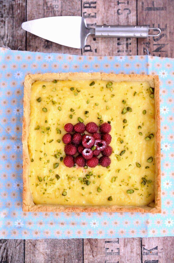 Olive oil, honey, lemon, raspberry and pistachio tart