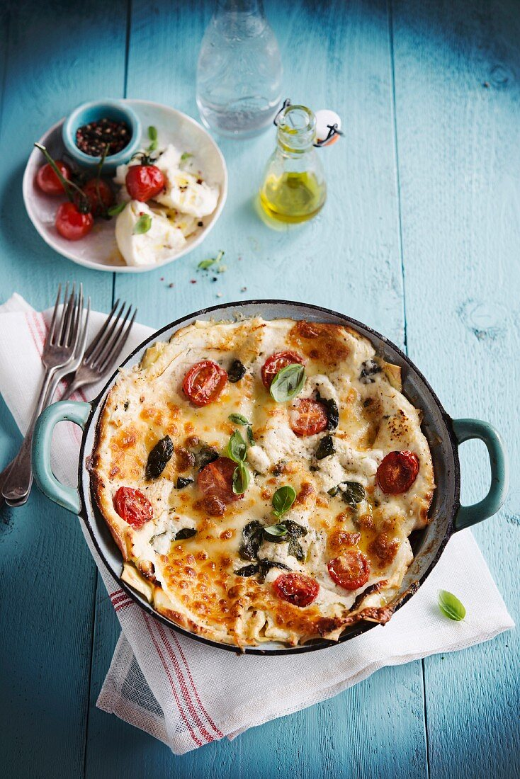 Vegetarian lasagna with mozzarella and tomatoes