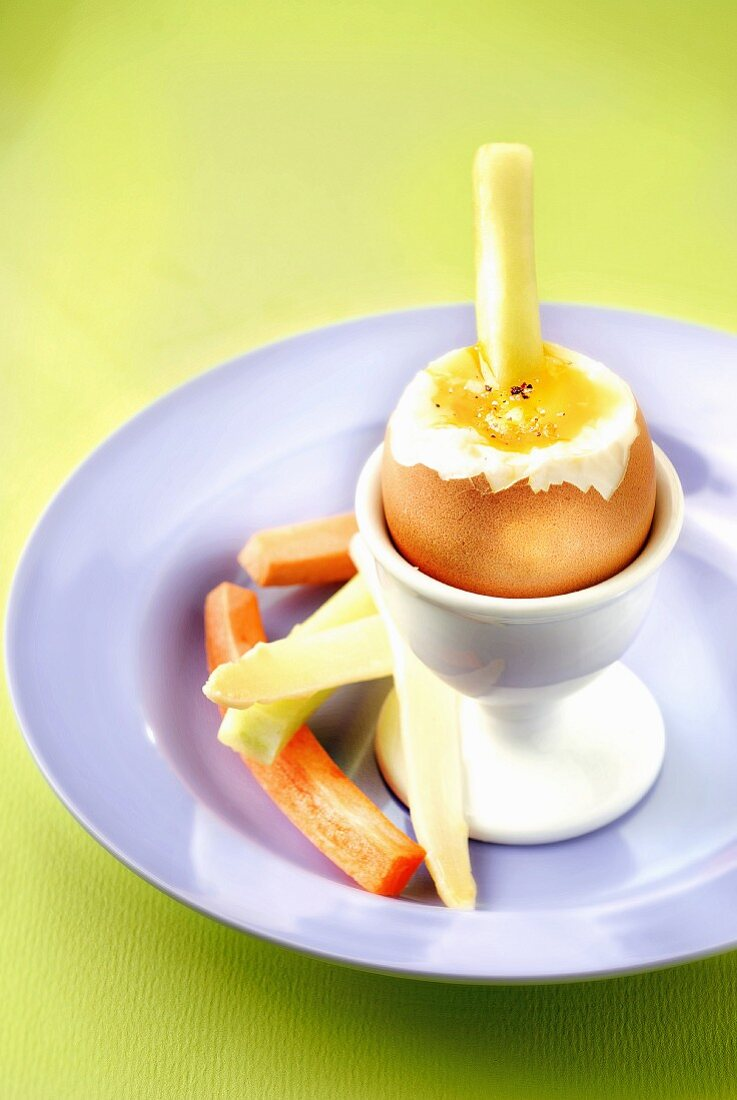Soft-boied egg with raw vegetable sticks