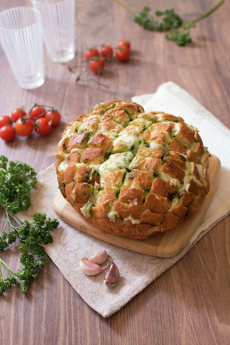 Bread with garlic butter, parsley and mozzarella