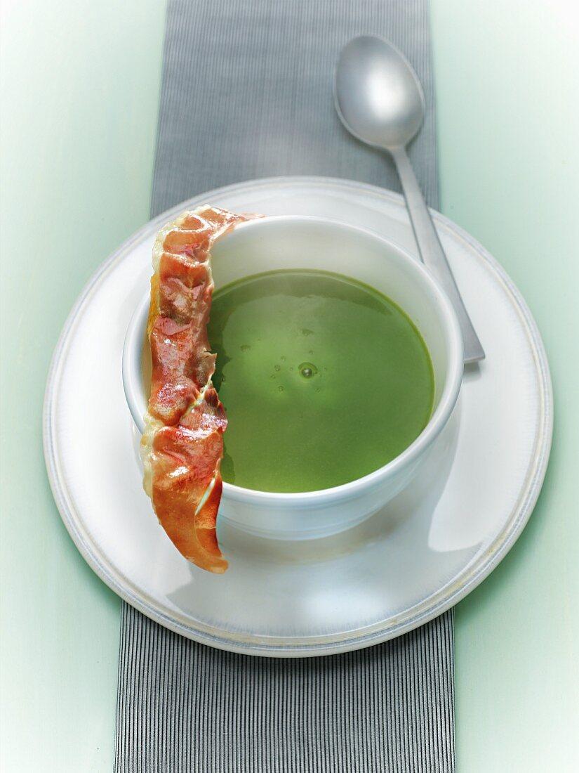 Cream of pea soup with crisp bacon