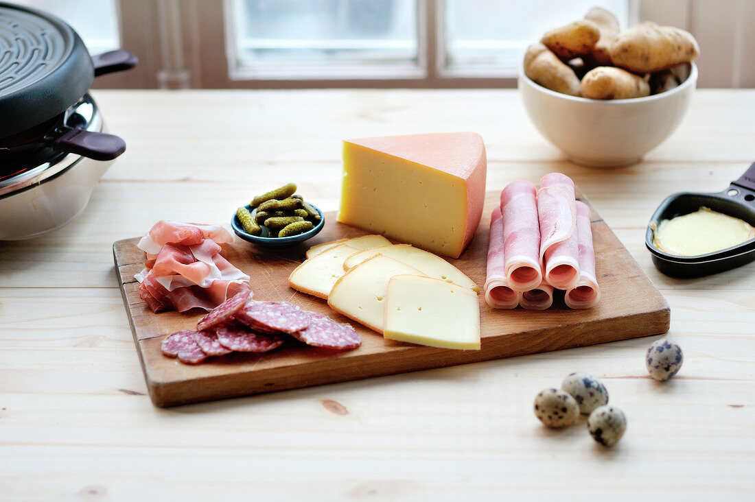 Ingredients and Raclette machine for a dinner