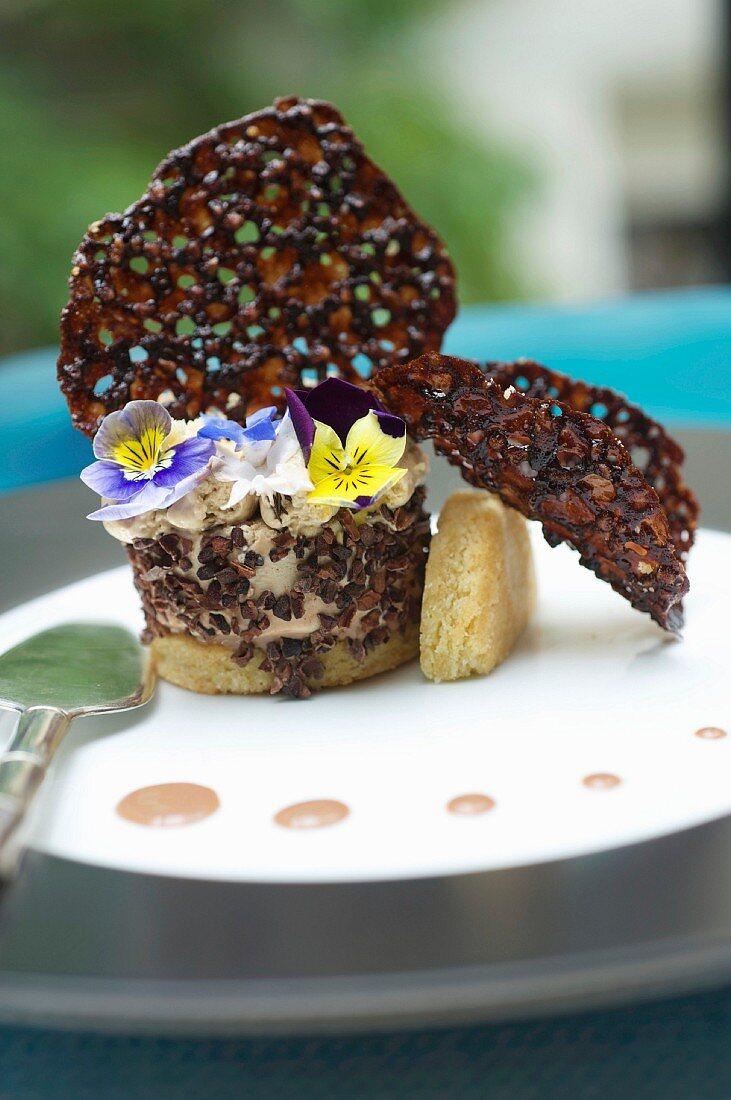 Mascarpone and coffee pudding with crushed cocoa bean tuile