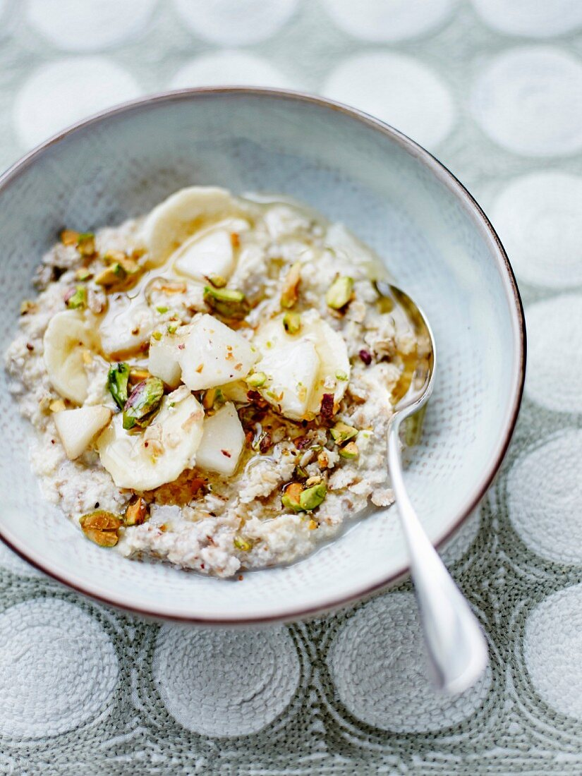 Millet and buckwheat porridge with rice milk, pear, banana and crushed pistachios