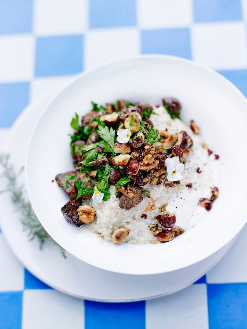 Quinoa risotto with almond cream, hazelnuts and meadow mushrooms