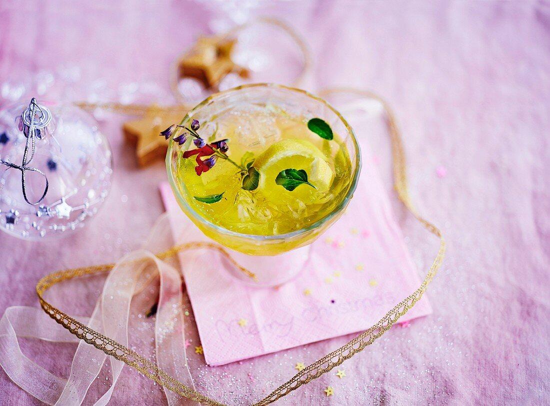 Suze, sage, mandarin orange juice and pineapple cocktail