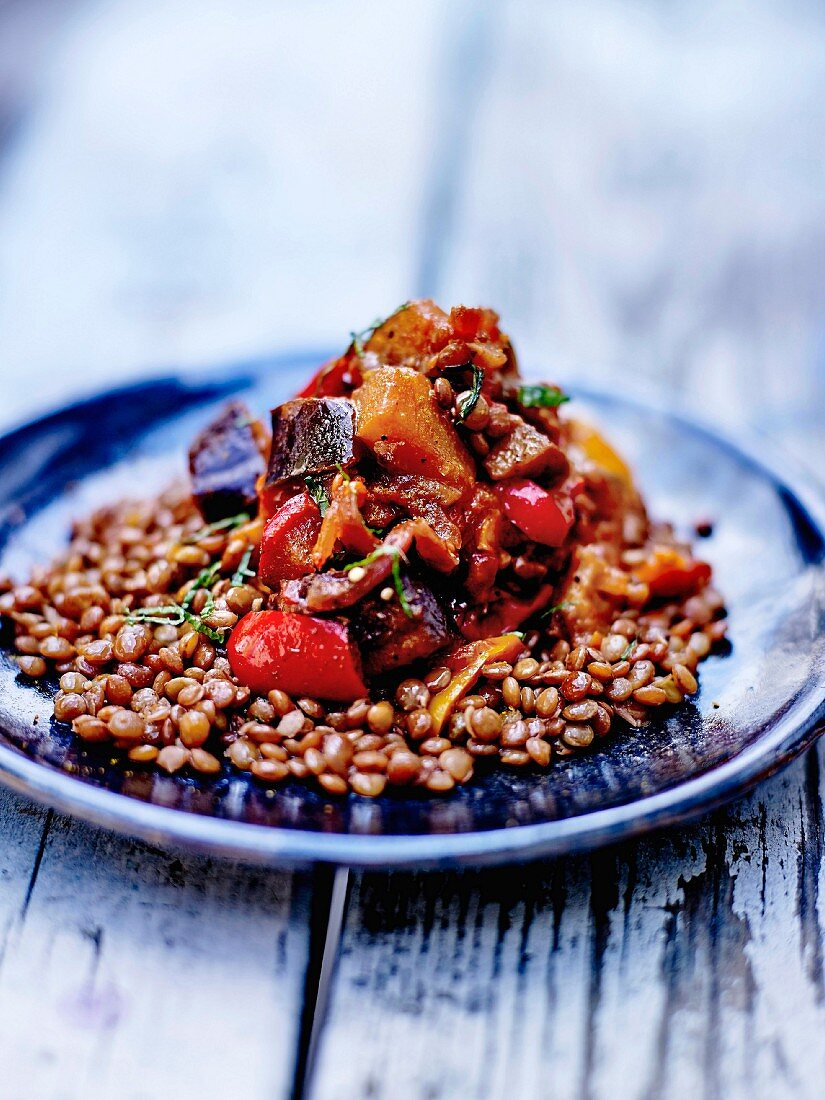Warm lentil salad with stewed red peppers and aubergines