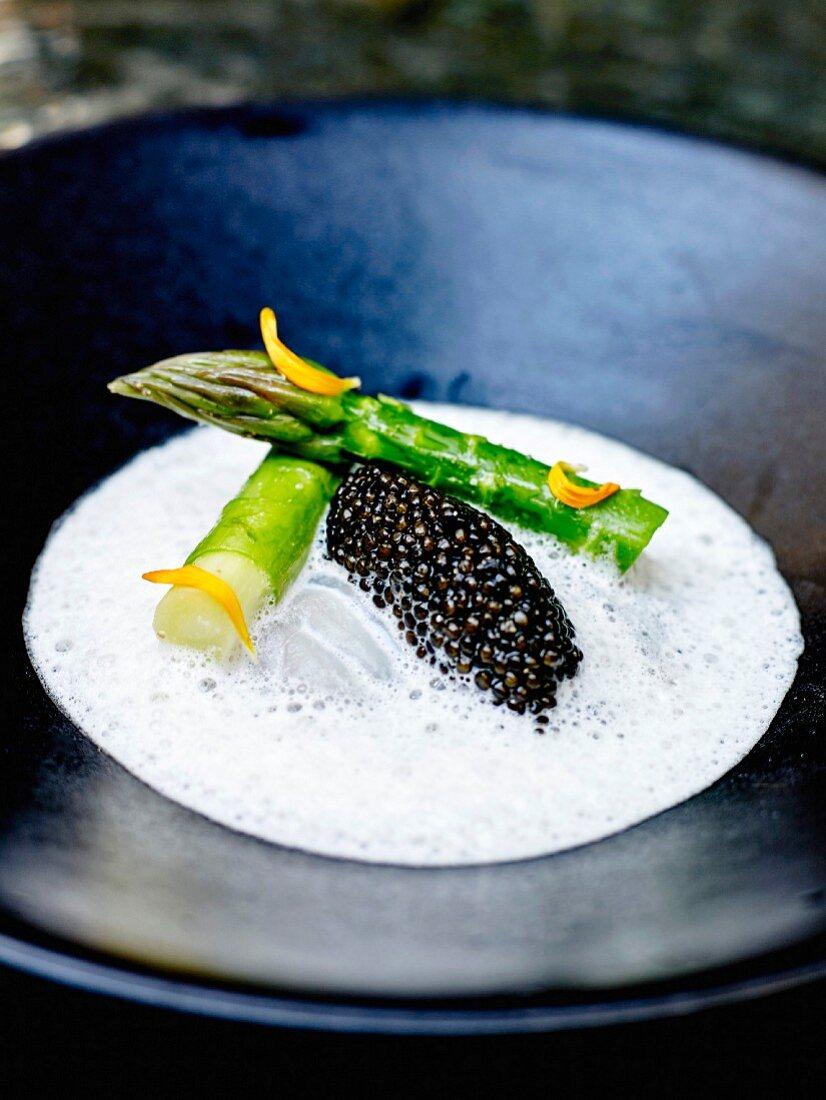 Bass in buttermilk cream, caviar and green asparagus