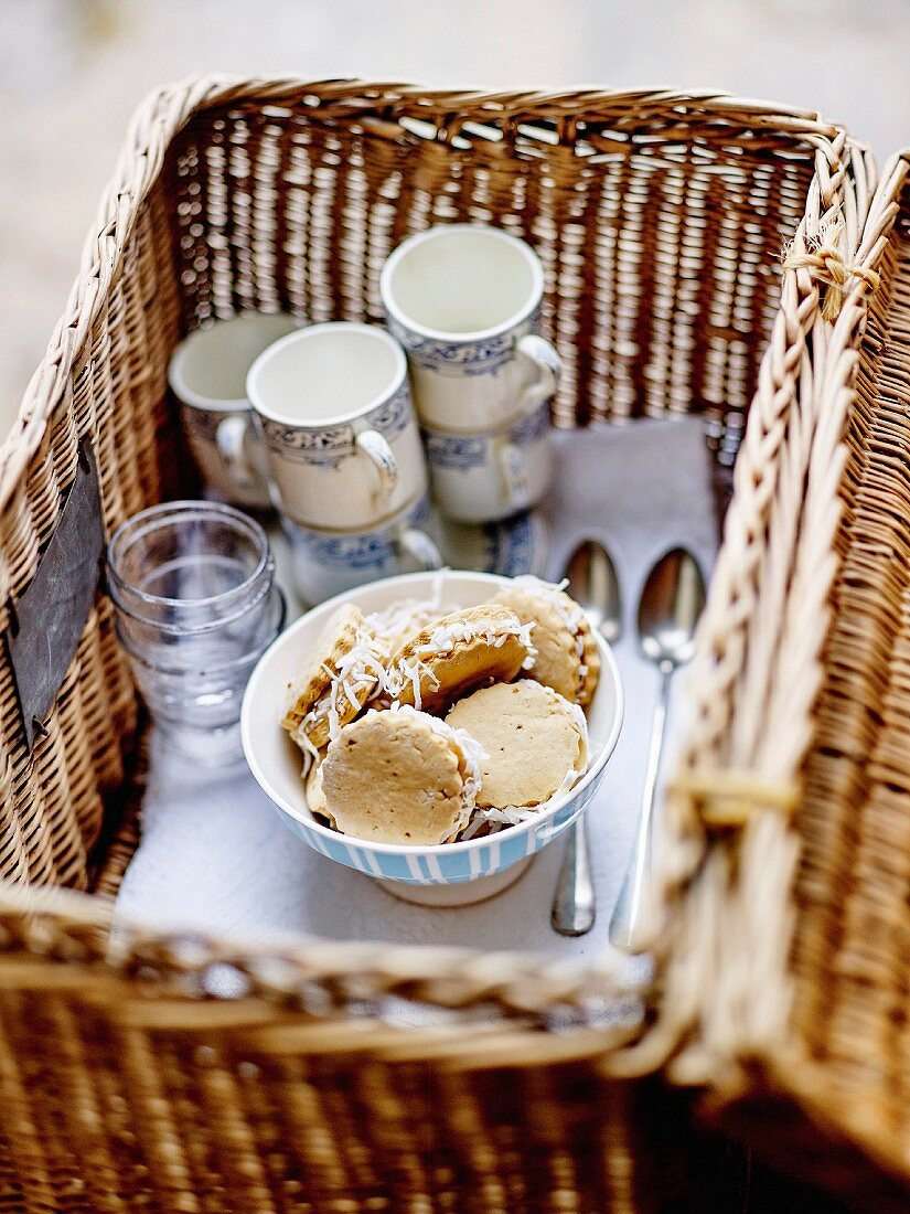 Milk jam and grated coconut Alfajores in a wicker basket