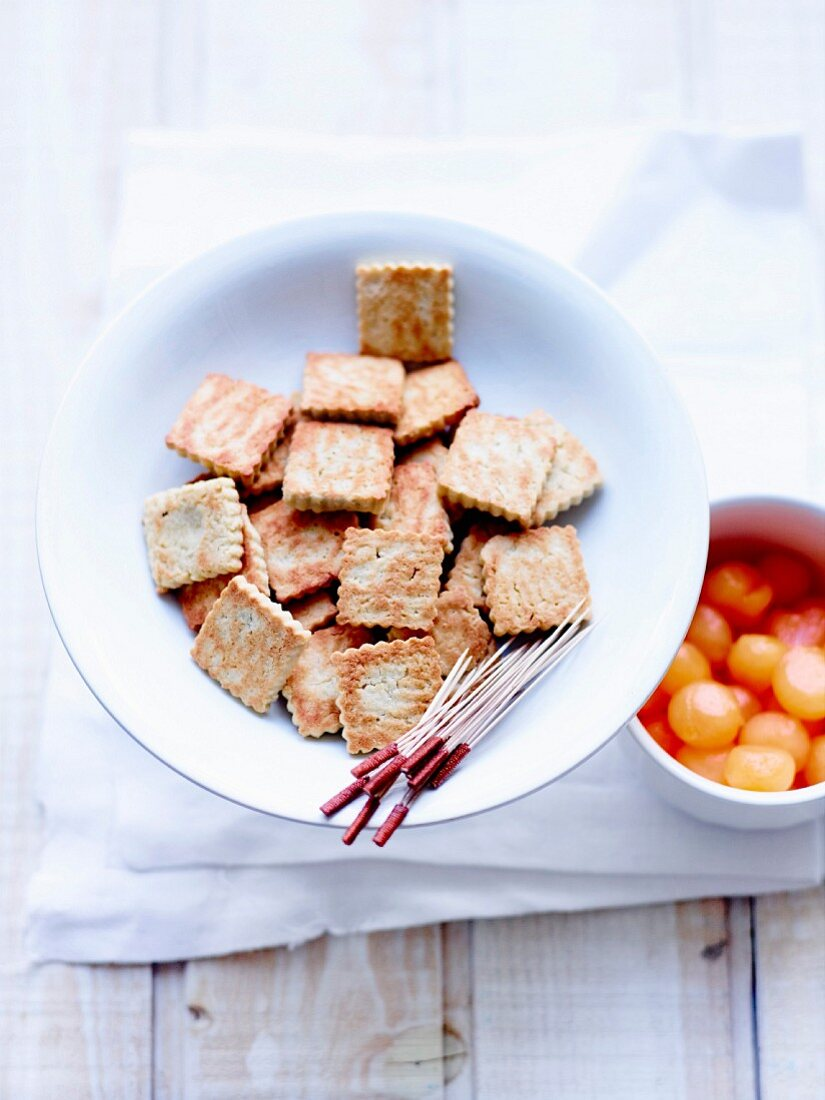 Gluten-free rice and chestnut flour and almond powder rich tea biscuits and melon balls