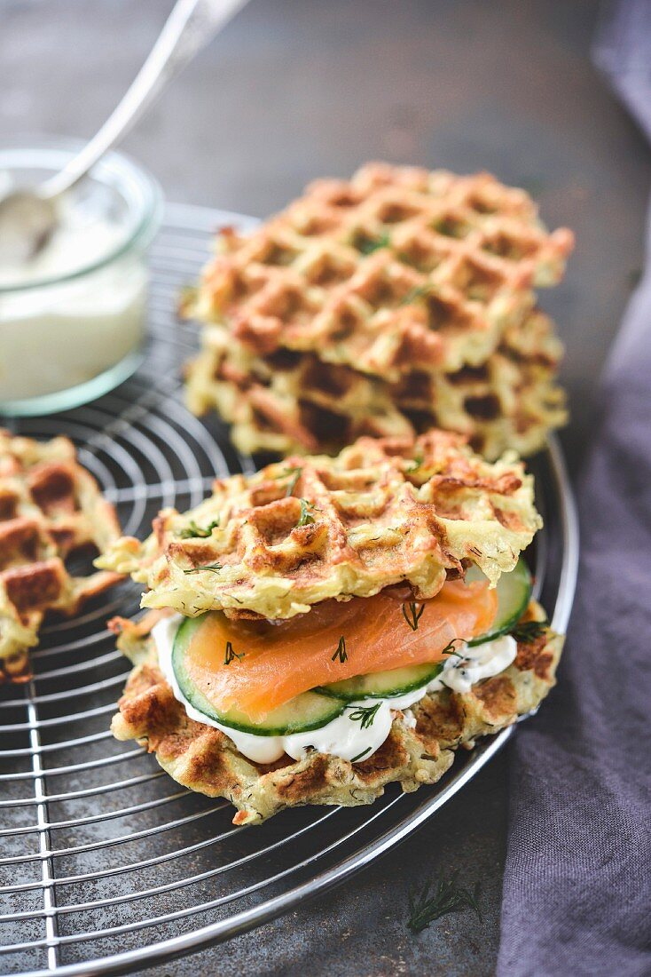 Potato waffles with dill cream,salmon and cucumber
