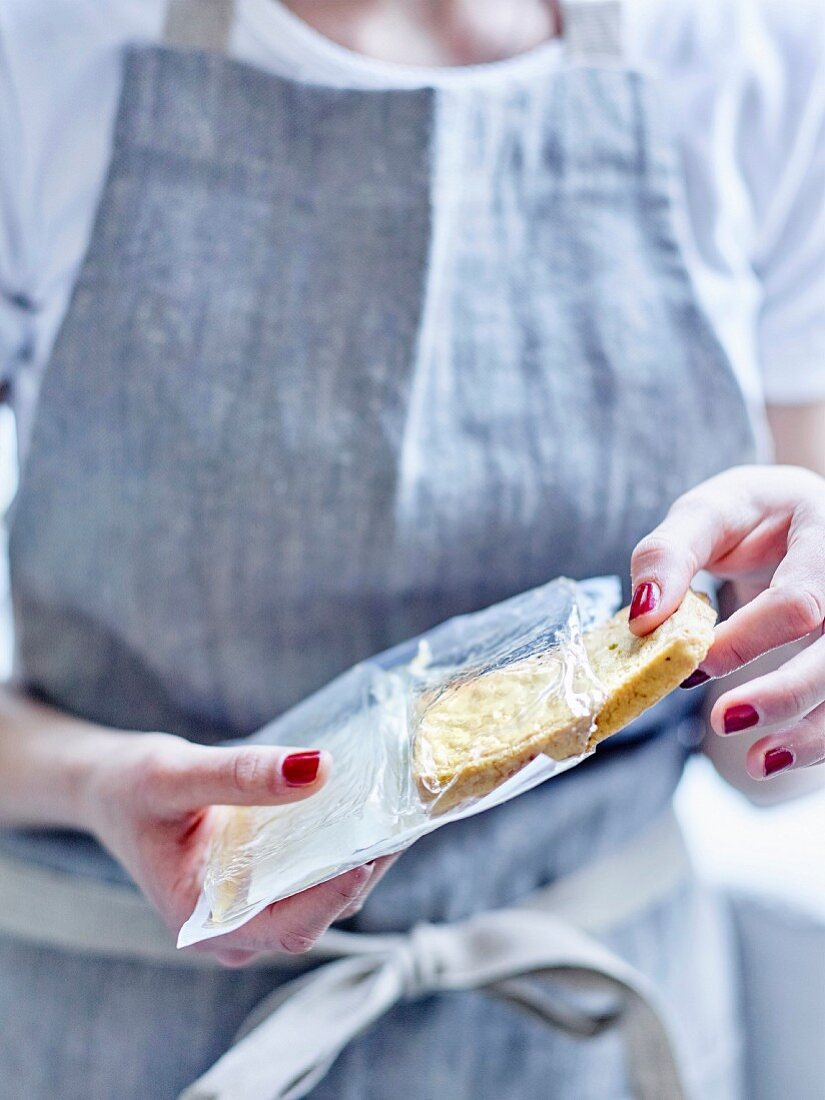 Woman removing tofu from it's package