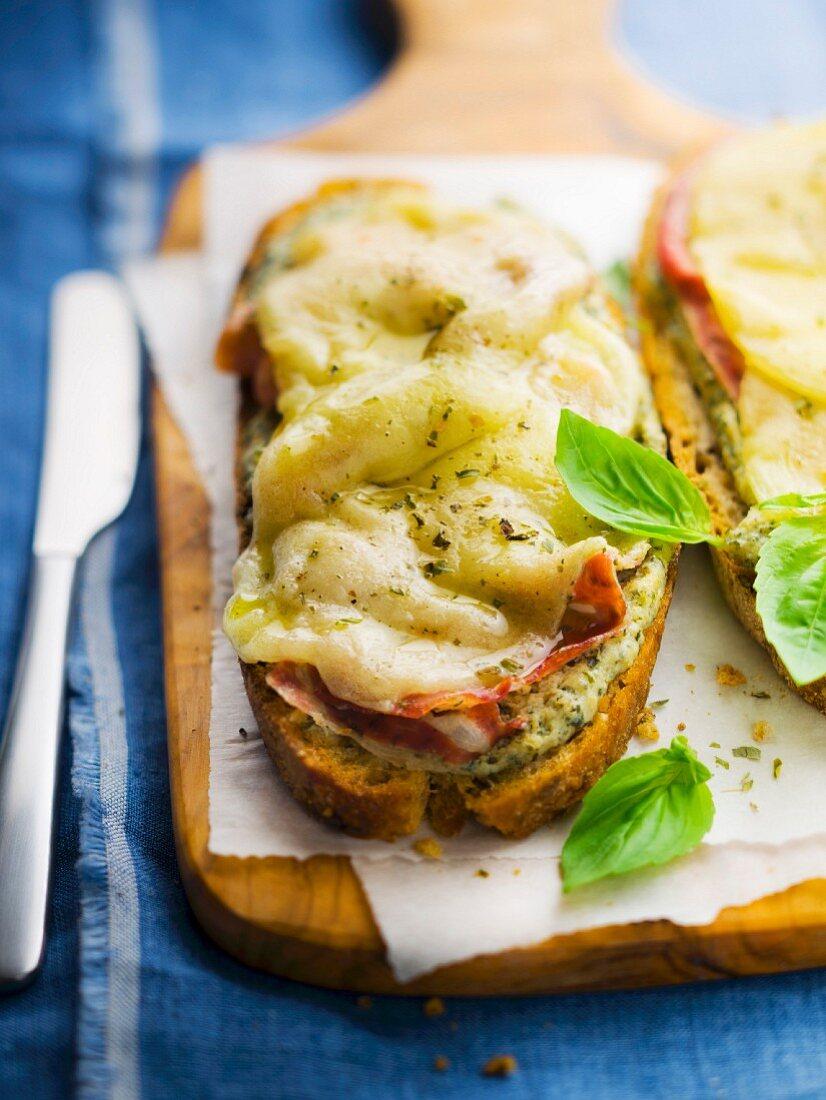 Parma ham, mozzarella and basil open sandwich