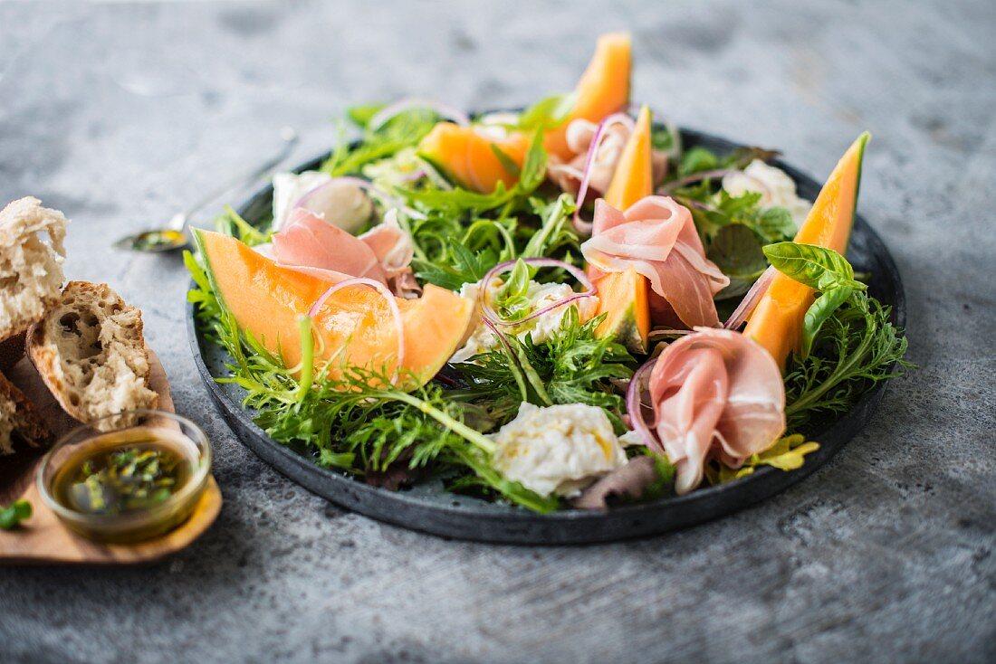 Melon, smoked ham and mozzarella salad