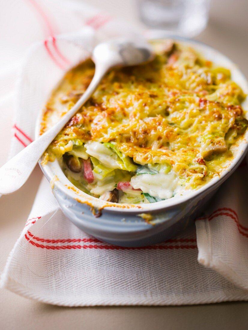 Vegetable ravioli and strips of raw ham gratin