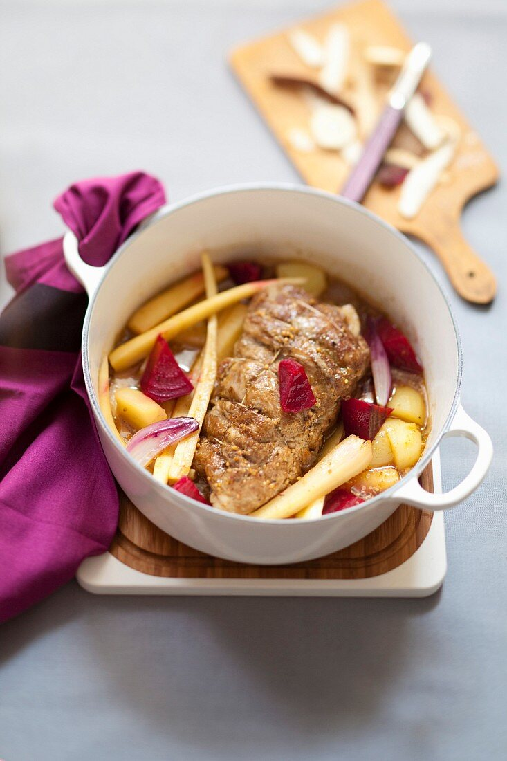 Veal filet mignon with mustard, potatoes, parsnip and beetroot casserole