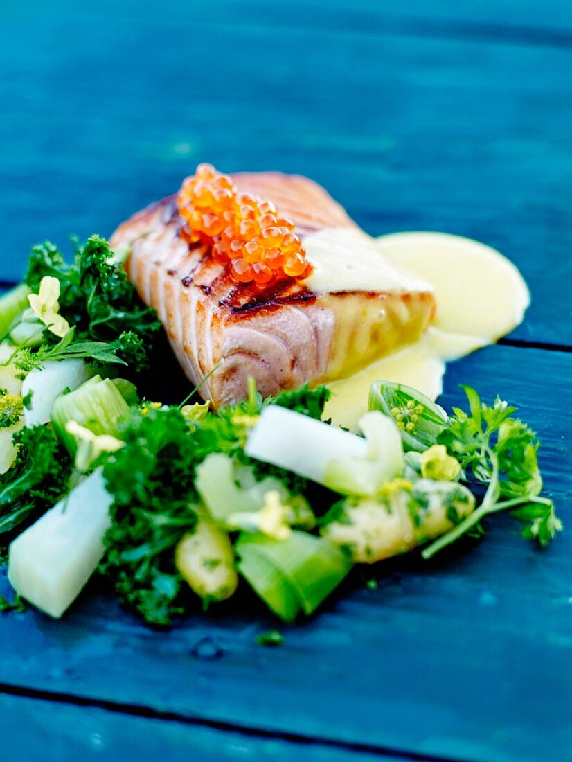 Roasted salmon fillet with salmon roe and orange-flavored hollandaise sauce, crisp vegetables