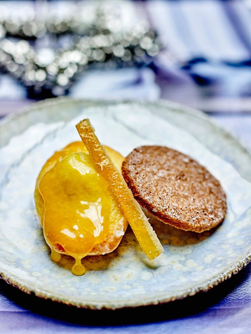 Madeleine with orange syrup, rice tuile with caramel and orange rinds